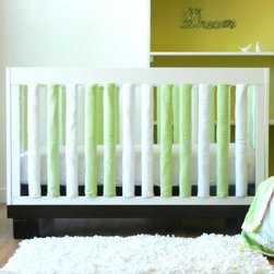 Go Mama Go Designs Wonder Bumpers - Green & White - Scientifically proven to be safe Go Mama Go Designs Wonder Bumpers - Green & White offer padded protection on the crib's hard rails without the risk of suffocation or entanglement. Compared to standard bumpers which have proven to be a suffocation risk Wonder Bumpers offer increased airflow and reduce CO2 re-breathing. They protect baby's head and body and inhibit toddlers from climbing out of their cribs. They also keep limps safely inside. Choose from a set of 24 or 38 Wonder Bumpers. Wonder Bumpers have a sleek vertical design that effortlessly zips onto your crib rails in a downward motion ensuring babies don't have access to the pull. With no ties to worry about they're easy to use and easy to wash.