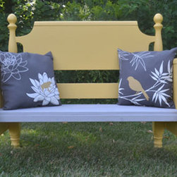 Repurposed Maple porch or house bench - An upcycled single bed has been transformed into a unique seating bench. It's a great piece to add to your covered porch, patio or inside your home. The bench is constructed from a solid maple head and footboard from a single sized bed, then painted a mellow yellow with a grey seat. The accompanying grey, white and deep yellow pillows tie the two bench colors together. This piece is a cute addition to any outside or inside living area. Polyurethane has been added to help protect the finish.