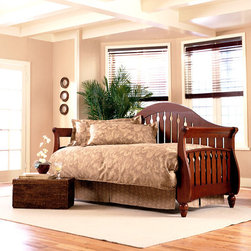"Leggett/Platt Fashion Bed - The Frazier Daybed w Link Spring in Walnut - It�۪s up to you how to display this truly beautiful bed with shapely curves. Fine wood frame graces every side of this work of art. Perfectly knobbed feet support this great piece. Enjoy the fine wood finish as you decorate your room with quality and sophistication. Available in two different finishes this bed will beautify any room in an instant. * Not Included: Mattress and Link spring. Back and Arms are made of 3 1/2"" wood slats. Poplar Wood. Finishes: Walnut, Black and Frost (white). Comes with a manufacturer 10 yr limited warranty. 99 in. L x 42 in. D x 49.5 in. H"