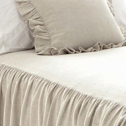 Wilton Natural Bedspread - Lovely in linen and cotton, the Wilton Natural Bedspread brings the definition of neutral color into a superb, stately take on the luxurious and structured coverlet.  Gathered, skirted sides and a smooth top enclose a bed in draperies of soft fabric in a natural flax tone.  The resulting look is effortlessly put-together and just vintage enough to suggest old-fashioned drama and grandeur.