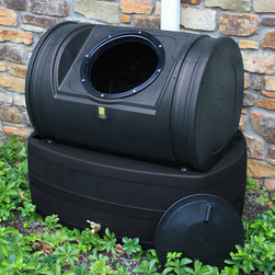 Good Ideas - Compost Wizard Hybrid 7 Cu. Ft. Tumbler Composter and 47 Gallon Rain Barrel - The Compost Wizard Hybrid is a combination rain barrel and tumbler composter that revolutionizes the way we do gardening. The innovative design cuts down cost (compared to buying a Rain Wizard 50 rain barrel and Compost Wizard Jr compost tumbler) and also saves space by reducing your footprint. But even more, the whole unit works together to fuse earth and water. As the top compost bin is rotated, gravity and centrifugal forces squeeze out excess compost tea from the compost which flows out onto the base where it's channeled into the barrel. From there it mixes directly with the rain water collected from your gutters forming nutrient packed plant food. When composting, simply add your ingredients through the large mouth 12'' lid and give it several good turns. As long as your compost batch stays between 100-150 degrees F, you should see compost within 2-6 weeks. The rain barrel base will hold 47 gallons of rain and compost tea which you can use as powerful plant food. Simply install the included spigot, and position at your preferred downspout and you're ready to go. You can pick the one that's right for you and your home or garden. Features: -Combination rain barrel and tumbler composter.-7 Cubic foot capacity and 47 gallon rain barrel.-Recessed handles for easy turning.-Wheeled base for effortless turning.-Large 12'' twist lid and aeration holes.-Pet and child friendly.-Directly mix tea with rain water.-Anti-debris screen on base.-Compost Wizard Collection.-Collection: Compost Wizard.-Distressed: No.-Country of Manufacture: United States.Dimensions: -Dimensions: 35'' H x 38'' W x 25'' D.-Weight: 40 lbs.-Overall Product Weight: 40 lbs.