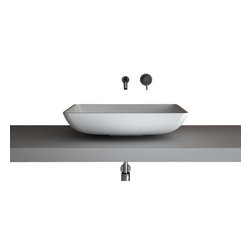 Maestrobath - Teknoform Net Elegant Rectangular Vessel Sink - This contemporary bathroom sink gently curves down towards the countertop it is sitting on and with its modern design attracts the attention of those who enjoy simplicity and a masterful execution. Created from TeknoForm, a durable polymer-based material, this modern vessel sink is available in a clean white color and will match your contemporary or classis design space perfectly.