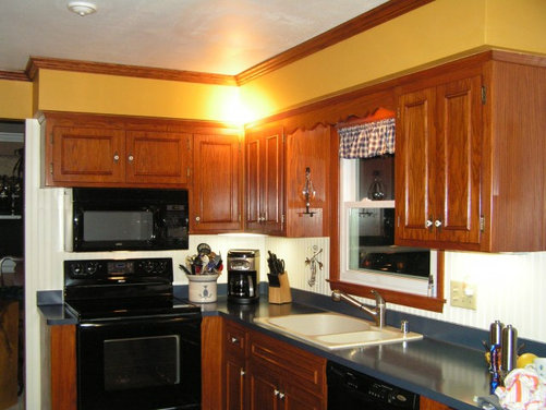 I would like to paint the mustard gold soffits i was for Cinnamon colored kitchen cabinets
