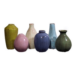 IMAX - IMAX Mini Tuscany Vases - Set of 6 - 35004-6 - Shop for Decorative Bowls and Vases from Hayneedle.com! The IMAX Mini Tuscany Vases - Set of 6 may be small in size but they're big on style. An easy elegant way to add color and visual interest to your home decor this set includes six mini vases of various shapes and sizes in a variety of soft soothing hues. Scatter them individually throughout your home or group them together on a table bookshelf or dresser for an eye-catching decorative accent. Exquisitely crafted from fine ceramic this set of miniature vases blends easily in both traditional or modern spaces alike.About IMAXWhat began as a small company importing copper flower containers in 1984 by Al and Faye Bulak has developed into one of the top U.S. import companies serving the At Home market today. IMAX now provides home and garden accessories imported from twelve countries around the world housed in a 500 000 square foot distribution center. Additional sourcing product development and showroom facilities in the USA India and China make IMAX a true global source. They're dedicated to providing products designed to meet your needs. This is achieved through a design and product development team that pushes creativity taste and fashion trends - layering styles periods textures and regions of the world - to create a visually delightful and meaningful environment. At IMAX they believe style integrity and great design can make living easier.