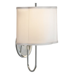 Simple Scallop Wall Sconce - A pair of scalloped wall sconces are perfect for outfitting a master bedroom. Keep the bedside tables piled high with reading material, while soft lighting illuminates from the wall. It's a stylish alternative to traditional table lamps.