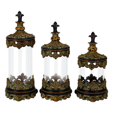 ecWorld - Urban Designs Fleur-De-Lis 3-Piece Glass Cylinder Canister Set - Antique Gold - Transform your decor with these smart canisters that bring new life and style to your home. The embossed Fleur-de-Lis finial tops on these clear cylinder glass canisters add a polished look as a decorative accessory. Not recommended for food storage.