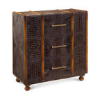 Carpathia Steamer Trunk - The fine details of the Carpathia Steamer Trunk play with unexpected uses of luxe materials for a richly-appointed, masculine storage piece that's packed with top-of-the-line vintage style. Warm wood bands around a trunk in java-colored faux crocodile are outlined with remarkably fine nailhead trim, giving contrast and dimension even as the ball feet finish off the look.