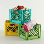 """Milk Crates - Milk crates take me back to my college days when I had a milk crate """"bookshelf"""" underneath my loft bed. Mine were boring and white, but I love the fun colors of these. Use them for outdoor storage, or keep them in a playroom to keep toys tidy and neat."""