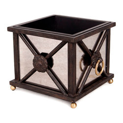 Astor Jardiniere - Short - Gold-leaf details add a touch of light to the sedate iron and glamorous antiqued mirror finishes of the Astor Jardiniere. Highlighted by a drop ring set into its classic cast floret, this cubic container makes the ideal cachepot for a topiary during holiday entertainments or provides a distinctive place to store the necessities of gracious everyday relaxation.