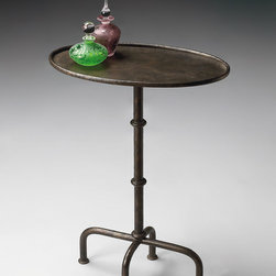 Metalworks Pedestal Table with Oval Top and Rustic Finish - There's a small iron side table next to one of the French armchairs in the Williams room, and this cute little one looks similar.
