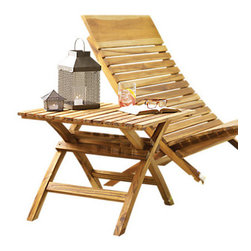 Design Ideas - Barcelona Beach Chair - Inspired by the classically simple line of its famous namesake, this casual take on a modernist classic is made from Laotian teak. This wonderful, durable wood has been missing from the market for a generation as plantations replenished supply. The chair folds flat for easy storage and transportation. It is quickly assembled with no screws, nuts, or bolts.