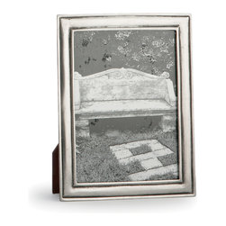 DaVinci Frame - 5 x 7 - Narrow and detailed with simple outlined edges around the slight dome of its center, the Da Vinci Frame surrounds your photos or small artwork pieces in a border that does not compete with color or overpower black and white, but enhances everything you place within. The antiqued coating that collects in its smooth grooves lends a luxe appearance of preserved tarnish to the silvery sheen of the natural Italian pewter.