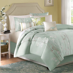 "Madison Park - Athena 7 Piece Jacquard Comforter Set in Blue - Decorate your room with this fresh floral jacquard bedding collection. The soft Sea Mist color is a perfect combination of blue and green that sits well in any bedroom, and is accented with shades of Ivory and Taupe. Features: -Available in Queen, King or California King sizes. -Set includes an oversized and over-filled comforter, two shams, a bed skirt and three accent pillows (18""x18"" square, 16""x16"" square and 12""x20"" oblong). -Material: 100% Polyester. -Color: Soft Sea Mist. -Decorate your room with this fresh floral jacquard bedding collection. -Combination of blue and green accented with shades of ivory and taupe."