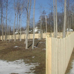 4' Cedar Board on Board - Made of Cedar, this fence is 4' tall and features little spacing between the boards.