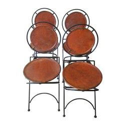 Mexican Leather Folding Chairs - Set of 4 - This set of four Mexican leather folding chairs is the type of unique find that makes us want to perform a one-person musical; since we'd probably burst every eardrum in the close to non-existent audience, we'll just throw a silent fiesta instead. The chairs were most likely produced between the '20s and '40s. They retain the original leather, which is certainly worn with age, however the distressed leather adds to the overall rustic aesthetic that drew us in initially.  They are also easily storable as they fold completely flat, so they make for great additional seating options during dinner parties.