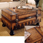 """Butler - Trunk Coffee Table w Leather Appointments & W - Bring a genuine treasure into your home.  Trunk styled coffee table is full of antique and exotic styling with leather appointments and a subtly imprinted, aged world map on the surface.  Oversized bun feet are just the right complement to the decorative embedded edging. * Laminated old world map surface with glaze and lacquer. Genuine leather appointments. Center storage drawer. Heritage Collection finish36""""W x 24""""D x 18""""H"""