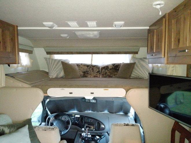 above cab loft space, seafoam grean paint, reupholstered window ...