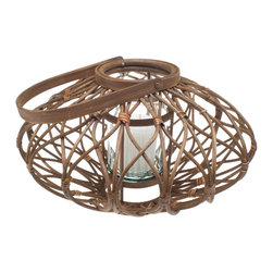 Candle Holders, Lanterns & Hurricanes - This lantern is intricately hand-woven from Rattan into the rather unusual discus shape while maintaining a classic look thanks to the finishing details. Once the candle is lit, its light casts an interesting geometrical shadow. The lantern is suited for indoor as well as outdoor use.