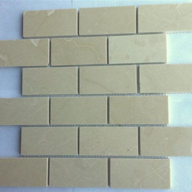 """Crema Marfil Polished Mesh-Mounted Marble Mosaic Tiles 2"""" x 4"""" - 2"""" x 4""""Crema Marfil Mesh-Mounted Marble Mosaic Tile is a great way to enhance your decor with a traditional aesthetic touch. This Polished Mosaic Tile is constructed from durable, impervious Marble material, comes in a smooth, unglazed finish and is suitable for installation on floors, walls and countertops in commercial and residential spaces such as bathrooms and kitchens."""