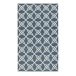 Safavieh - Handmade Thom Filicia Tioga Ink Blue Outdoor Rug (3' x 5') - This indoor/outdoor rug has a background color of blue and displays white accents. This handwoven rug is made from recycled plastic bottles and is resistant to mold,mildew,sun,water and other elements.