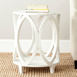 Safavieh Janika Accent Table - Off White - Bring back the elegance of the Art Deco period with the striking look of the Safavieh Janika Accent Table - Off White. The compact design easily fits into even the smallest rooms, while the lovely geometric design beautifully highlights your style. Updated colors bring this classic design up to date, making a distinctive statement. Available in Ash Grey, Dark Teal, or Off White finish.About SafaviehConsidered the authority on fine quality, craftsmanship, and style since their inception in 1914, Safavieh is most successful in the home furnishings industry thanks to their talent for combining high tech with high touch. For four generations, the family behind the Safavieh brand has dedicated its talents and resources to providing uncompromising quality. They hold the durability, beauty, and artistry of their handmade rugs, well-crafted furniture, and decorative accents in the highest regard. That's why they focus their efforts on developing the highest quality products to suit the broadest range of budgets. Their mission is perpetuate the interior furnishings craft and lead with innovation while preserving centuries-old traditions in categories from antique reproductions to fashion-forward contemporary trends.