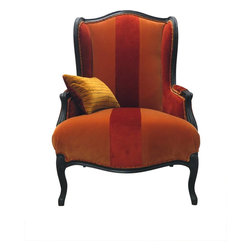 Madera Home - Red and Orange Velvet Wingback Chair - This cosy velvet wingback chair has a sumptuous urban lodge feel and was designed by the celebrated textile artist, Veronese Bellarte, and features an antique frame. Cuddle up with a book and use it to warm up your living room.