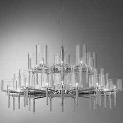 AXO Light - Spillray 2-Tier Chandelier by AXO Light - Transparently beautiful. The AXO Light Spillray 2-Tier Chandelier cleanly presents a double ring of variably scaled Pyrex glass goblets, the drinks of light ranging from short and stout to long and lean. Symmetrically arrayed around a contemporary Chrome frame, the different shade profiles add welcome dimensional depth. The low voltage Spillray is dimmable with the addition of an electronic low voltage dimmer (not included). Italy's AXO Light combines traditional Venetian glasswork and artisan craftwork with avant-garde lighting techniques and innovative materials. Their design philosophy is clear: use creativity and inspiration to create stunning lighting replete with value and emotion.