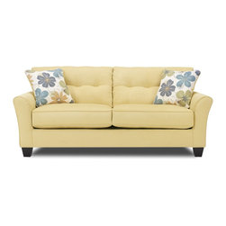 Kylee Gold Sofa - With its sunny yellow upholstery and comfortable support, the Kylee Gold sofa will surely put a smile on your face. Flared arms and floral accent pillows – which reverse to match the body fabric – add to the contagious carefree spirit, while tufted back cushions, welted seams and tapered legs instill subtle sophistication.