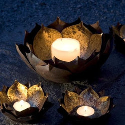 Gold Leafed Metal Lotus Flower Candle Bowls - I love these unique candle holders. The lotus shape cradles the light with such an interesting patina.
