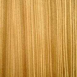 Zebrawood Veneer - Zebrawood veneer has nice vertical grains with bold light tan to dark brown contrasting stripes. The contrasting grain can be tightly spaced or slightly wider but always an alternating light and dark contrast. Zebrawood is almost exclusively quarter cut only to produce the characteristic stripe. Available in a variety of backers and sizes.