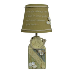A Homestead Shoppe - A Homestead Shoppe Shell Buoy Accent Table Lamp Multicolor - L2137BL-UP1 - Shop for Lamps from Hayneedle.com! Bring a touch of the beach to your home with the A Homestead Shoppe Shell Buoy Accent Table Lamp. Showcasing sea shell and rope accents this durable table lamp is constructed of resin that is built to last. Its empire tan burlap shade is embellished with embroidery that says May you always have a shell in your pocket and sand between your toes along with a top and bottom rope trim and a cluster of sea shell accents. Requires one 25-watt candelabra bulb (not included) that provides ample lighting over end tables nightstands and desk tops.About AHS LightingAHS Lighting and Home Decor is a gift and home decor company that has been in business for over 41 years. They have been making lamp shades domestically for over 25 years! In 2011 Carole and Stuart Miller purchased the company which now focuses more on lamps and lampshades. The AHS lighting and Home Decor workroom sits amidst the corn and soy fields of Northern Indiana. They also have showrooms in Atlanta Georgia. The credo of AHS Lighting and Home Decor is: provide value priced gifts and home decor lighting and lampshades beyond customer expectations.
