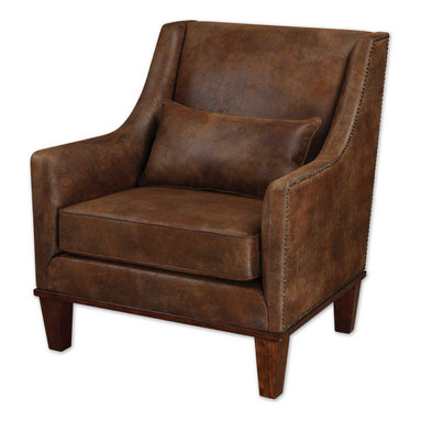 Uttermost - Clay Leather Armchair - You know that old club chair in your room? The one that's slightly tatty and needs an upholstery job? This chair is its better half. It still has that same feeling of comfort and ease but it's updated. The velvety soft fabric looks like distressed leather and the antique brass nail heads keep it masculine.
