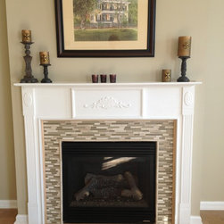 Wood-look tile on the floor and glass mosaic on fireplace - Wood-look tile and glass mosaic backsplash