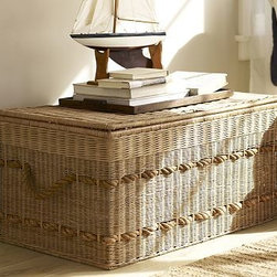 """Woven Trunk with Rope Handles - Generously sized to hold a full summer's worth of bedding, books and games, this trunk is a beach house essential. It's handwoven and accented with thick nautical rope that forms its handles. 38"""" wide x 22"""" deep x 19"""" high Handcrafted of rattan over a welded metal frame. Removable top with cut-out handle opening. Abaca rope woven around trunk. Hand-applied lacquer sealant."""