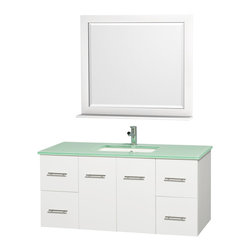 Wyndham Collection - 4 Drawer Bathroom Vanity Set in White - Includes one square porcelain undermount sink and matching mirror with shelf. Faucet not included. Two functional doors. Plenty of storage and counter space. Single faucet hole mount. Green glass top. Engineered to prevent warping and last a lifetime. 12 stage wood preparation, sanding, painting and finishing process. Highly water resistant low V.O.C. sealed finish. Unique and striking contemporary design. Modern wall mount design. Deep doweled drawers. Fully extending under mount soft close drawer slides. Concealed soft close door hinges. Made from solid oak hardwood. Brushed chrome exterior hardware finish. Vanity: 48 in. W x 21.5 in. D x 22.75 in. H. Mirror: 36 in. W x 33 in. H. Care Instruction. Assembly instructions - Vanity. Assembly instructions - Counter Top. Assembly instructions - Undermount Sink. Assembly instructions - MirrorSimplicity and elegance combine in the perfect lines of the Centra vanity by the (No Suggestions) Collection. If cutting edge contemporary design is your style then the Centra vanity is for you modern, chic and built to last a lifetime. You'll never hear a noisy door again! The attention to detail on this beautiful vanity is second to none.