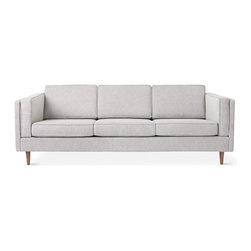 Gus Modern - Adelaide Sofa by Gus Modern - Burnaby Summit - The Adelaide Sofa is a classic club sofa frame that harkens back to Mid-century archetypes. Structured side cushions lend a vintage look, and provide added comfort. The solid, tapered-wood legs can be easily removed and reattached, allowing this sofa to fit through tight spaces. The sofa frame and legs are FSC®-Certified wood, in support of responsible forest management.