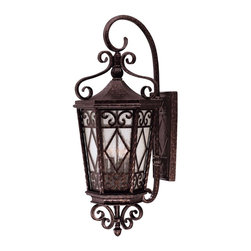 "Savoy House - Felicity Wall Mount Lantern - This lantern makes a elegant statement, right in front of your home. The intricate details of the hammered metal frame are stunning, and the soft, cream-textured glass lets off the coziest glow. Say ""welcome home"" in style with this brilliant lantern."