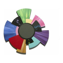 Alisa Diva - Color Discus Abstract Geometric Wooden Wall Hanging - It's a wheel of fortune and the Color Discus Abstract Geometric Wooden Wall Hanging is ablaze with color. Disks of bright colors are fused together at various angles to form a geometric wonder. This circular puzzle will be one of your most unusual wall pieces and will be a conversation piece. Center it over a couch or mantle in your living room. Hang it over a dining room buffet or in a breakfast nook. Add it to a young person's bedroom or in a brightly colored bathroom. This item could even be a graduation gift for a student dorm.