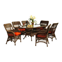 Wicker Paradise - Outdoor Wicker Dining Set of 7 - Princeton - Enjoy the company of friends and family around this vinyl wicker dining set crafted on an aluminum frame. The oval dining table features a hole for an umbrella (if you do not need the hole, we include a plug to cover the hole) with tempered glass top and 6 comfortable wicker dining chairs.  Call your friends and throw a party! Gather around the oval outdoor wicker dining table for a fun time. Eat, be merry and raise your glasses for a enjoyable gathering. Your dining table and chairs have beautifully woven lattice work and great detail. Show off your taste with a selection of many striking fabrics. This adds the visual pop necessary to attract all the attention to your wicker showpiece.