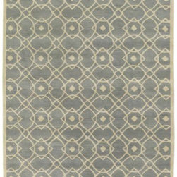 "Hand-Tufted Glamorous Seafoam Wool Rug - You know how you agonize, sometimes for days, over purchasing something as tough to buy in the ""real world"" as a rug online? That was me. I looked for months and months, and one day I finally decided to pull the trigger. This rug is perfect in color, is reasonably priced and was of acceptable quality for the money. I also use the runner in my master bath in front of twin sinks to tie the master bed and bath together. I'd give it four out of five stars due to uneven threads and shedding."