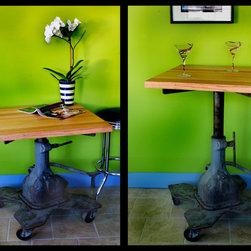 Furniture & Fixtures - This re-purposed vintage 30's era machinist table features a freshly re-milled top from a school desk, a hydraulic lifting feature, and steel casters. That make this table a versatile piece for any home...rolls from being a nightstand or end table to a bistro table or bar!