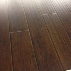 Laminate - Metropolitan Walnut 12.3 mm hand scraped with pad attached