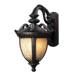 Z-Lite - Z-Lite 2141S-BG Winchester 1 Light Outdoor Wall Light in Black Gold - With a striking design influenced from centuries past, this small outdoor wall mount is truly a work of traditional elegance. Finished in black gold, the majestic curves and feathered details work perfectly with the mottled amber glass, which casts a rich glow. Made of cast aluminum, these fixtures will stand up to all of nature's elements.