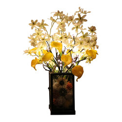 The Firefly Garden - Breakfast at Tiffany's - Illuminated Floral Design, Yellow, Brown Jewel Lantern - Breakfast at Tiffany's is a playful yet elegant, illuminated experience inspired by the classic film starring Audrey Hepburn. Delicate lighted branches, Calla Lilies and cream silk flowers gently swoon over a vintage glass lantern like a willow tree. This arrangement offers a variety of lighted branch options to suit your personal style or event.