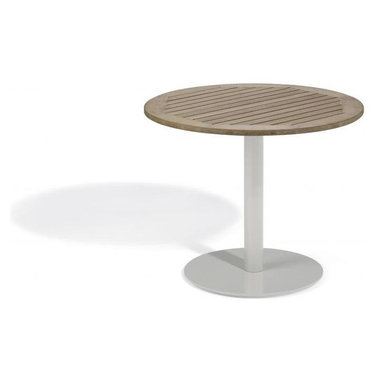 Oxford Garden - Travira 36 Bistro Table, Tekwood Vintage - The Travira 36 Bistro is a stylish table that features a classic, yet modern round top and base. The table top is available in Teak, Tekwood (Natural or Vintage) or Alstone, complementing the bold gray of the powder-coated aluminum. The Travira bistro is perfect for a balcony, cafe or other outdoor dining environment. Tekwood: Table top made from Tekwood, a wood-alternative developed from polystyrene. Tekwood provides the look of wood without the weathering process or maintenance.