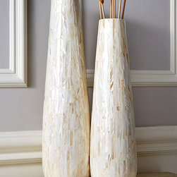 Mop Tapered Vases - Set of 2 - Vertical, curvaceous forms with slender proportions are familiar companions of transitional decor, but the smooth shape of these Mother of Pearl Tapered Vases is made elementally appealing by the tiles of soft ivory shell material that form the lustrous walls. Used as decorative containers or as sculpture, this appealing pair of vessels stands tall enough to earn notice.