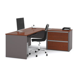 Bestar - Bestar Connexion Bordeaux & Slate 71 x 83 L-Shaped Workstation Desk - The desk is made of durable 1 inch commercial grade work surface with melamine finish that resist scratches stains and wears. It features an impact resistant 0.25 cm PVC edge. Grommets are available on the station for efficient wire management. The credenza and the return table meet or exceed ANSI/BIFMA performance standards. The oversized pedestal offers two file drawers with letter/legal filing system. The drawers are on ball-bearing slides and the keyboard drawer features double-extension slides for a smooth and quiet operation. The station is fully reversible. Also available in Slate and Sandstone finish. Connexion is a contemporary and durable collection that features a wide variety of configuration options that will adapt to your specific needs.Nowadays performance productivity and quality of life are fundamental to achieving our personal and professional goals. Bestar's home and office furniture design is based upon these criteria as well as on today's reality. On average we spend about 40 hours a week at work (home or office) which represents a large portion of our time. Various factors have a direct impact on our well-being at work: an important concern in the current employment environment continually changing and at an ever-increasing pace. Therefore organizing your space is certainly a parameter to consider. Features include Strong and large work surface Plenty of room to organize your documents Multiple configuration options. Specifications Finish/color: Bordeaux & Slate.