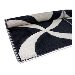 KOKO - Waves Print Floor Mat, Black and Ivory - These waves feel modern and fresh. You could stash a few of these in the car for impromptu beach trips. They're stylish and easy to clean since you can simply hose them off at the end of the day.