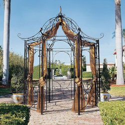 Design Toscano - Design Toscano The Amelie Architectural Steel Garden Gazebo - FZ397 - Shop for Gazebos from Hayneedle.com! Elegantly detailed the Amelie Architectural Steel Garden Gazebo adds a beautiful accent to any outdoor setting. This piece is crafted of powder-coated tubular steel and can be used in a variety of ways to enhance your garden or yard.About Design Toscano: Design Toscano is the country's premier source for statues and other historical and antique replicas which are available through our catalog and website.We were named in Inc. magazine's list of the 500 fastest growing privately-held companies for three consecutive years - an honor unprecedented among catalogers.Our founders Michael and Marilyn Stopka created Design Toscano in 1990. While on a trip to Paris the Stopkas first saw the marvelous carvings of gargoyles and water spouts at the Notre Dame Cathedral. Inspired by the beauty and mystery of these pieces they decided to introduce the world of medieval gargoyles to America in 1993. On a later trip to Albi France the Stopkas had the pleasure of being exposed to the world of Jacquard tapestries that they added quickly to the growing catalog. Since then our product line has grown to include Egyptian Medieval and other period pieces that are now among the current favorites of Design Toscano customers along with an extensive collection of garden fountains statuary authentic canvas replicas of oil painting masterpieces and other antique art reproductions.At Design Toscano we pride ourselves on attention to detail by traveling directly to the source for all historical replicas. Over 90% of our catalog offerings are exclusive to the Design Toscano brand allowing us to present unusual decorative items unavailable elsewhere. Our attention to detail extends throughout the company especially in the areas of customer service and shipping.