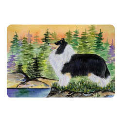 Caroline's Treasures - Collie Kitchen or Bath Mat 20 x 30 - Kitchen or Bath Comfort Floor Mat This mat is 20 inch by 30 inch. Comfort Mat / Carpet / Rug that is Made and Printed in the USA. A foam cushion is attached to the bottom of the mat for comfort when standing. The mat has been permanently dyed for moderate traffic. Durable and fade resistant. The back of the mat is rubber backed to keep the mat from slipping on a smooth floor. Use pressure and water from garden hose or power washer to clean the mat. Vacuuming only with the hard wood floor setting, as to not pull up the knap of the felt. Avoid soap or cleaner that produces suds when cleaning. It will be difficult to get the suds out of the mat.